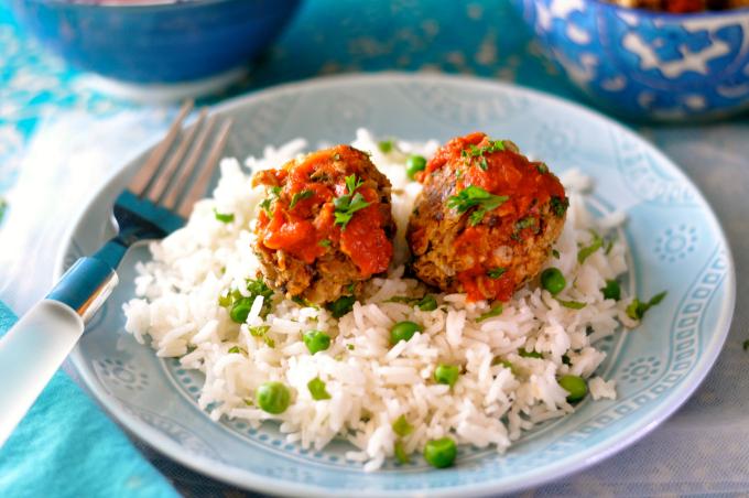 Vegan meatballs over basmati rice and peas smothered in tomato sauce. (#vegan) ordinaryvegan.net