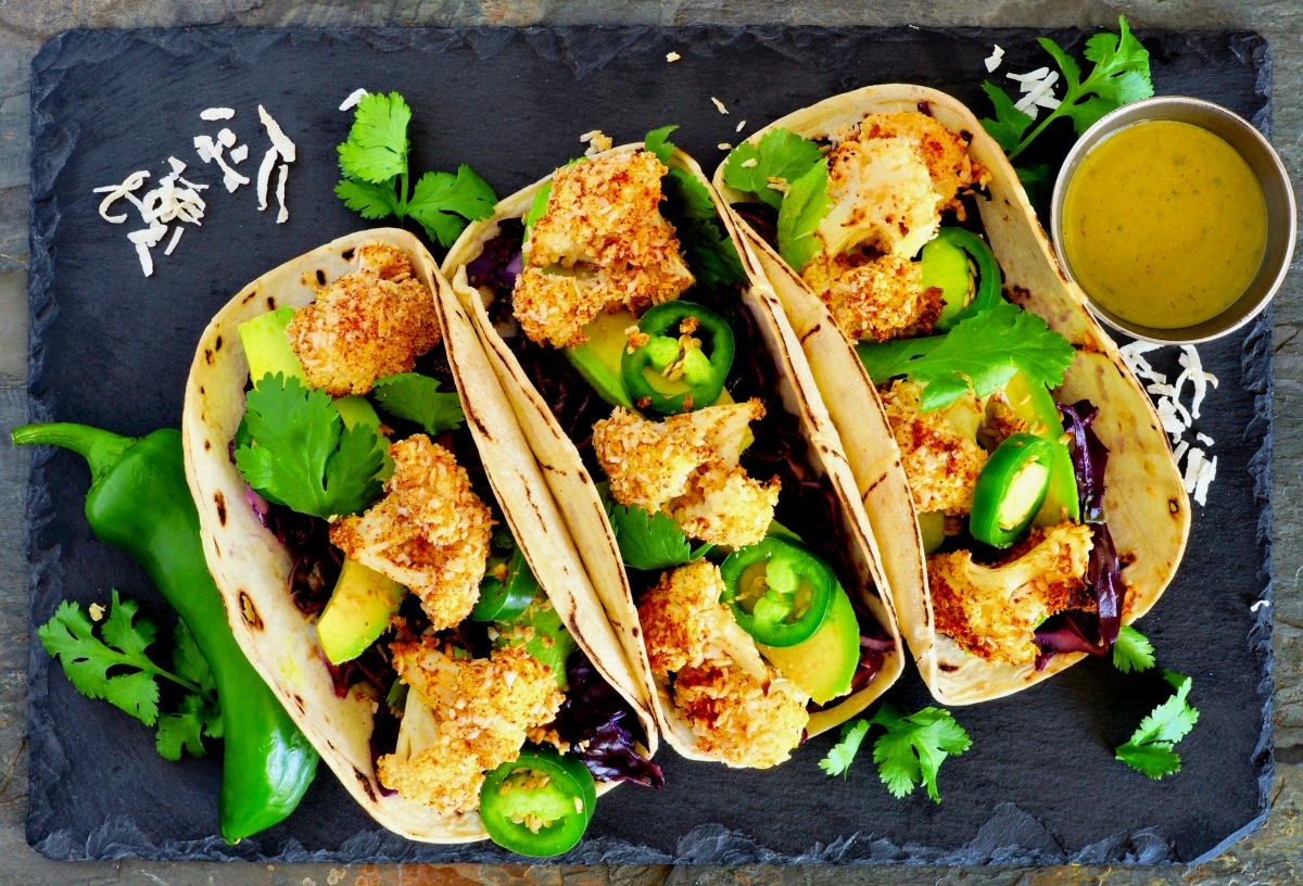 These healthy, gluten-free vegan cauliflower tacos explode with crunchy texture and flavor, and topped with the perfect tangy and sweet mustard sauce. (#vegan) ordinaryvegan.net