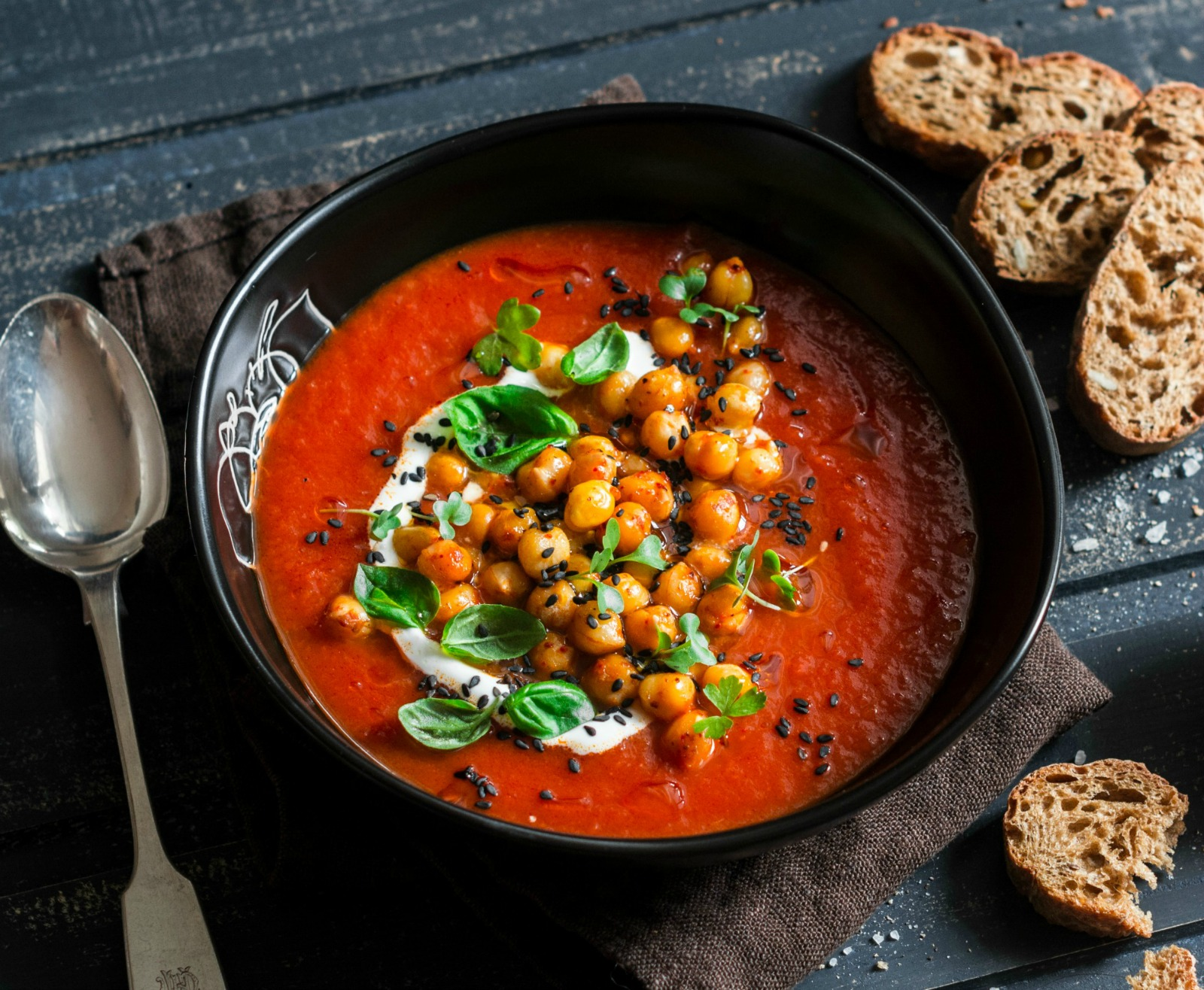 Hands down, this delicious vegan tomato soup made with fire roasted tomatoes and topped with roasted chickpeas is the best tomato soup you'll ever have. (#vegan) ordinaryvegan.net
