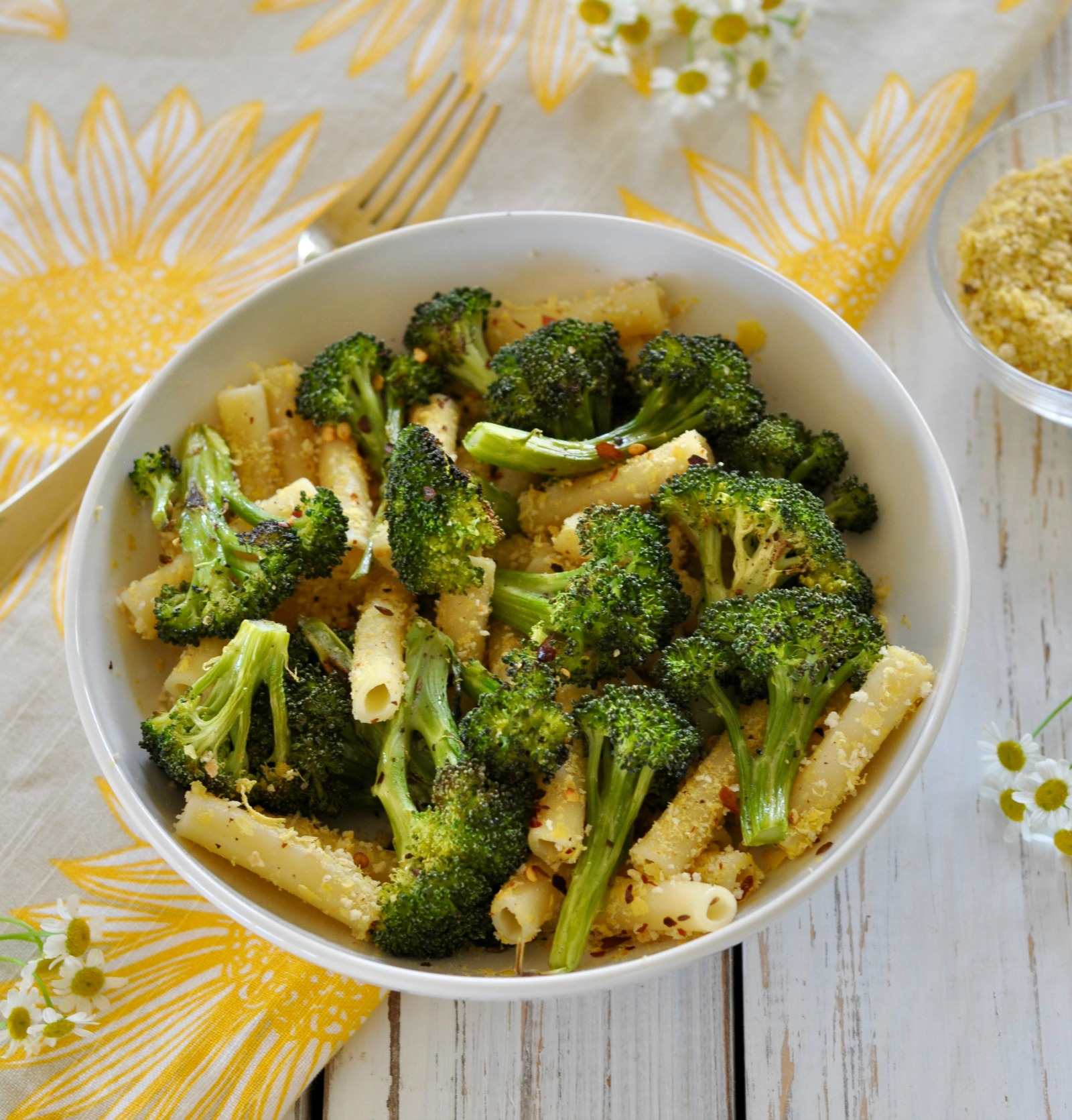 This roasted, dairy-free, low caloric, spicy broccoli pasta topped off with a lemon breadcrumb flavor bomb is a quick and easy dish the entire family will love. (#vegan) ordinaryvegan.net